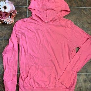 Very cute pink light sweater.